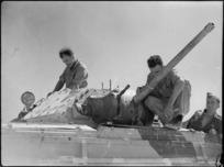 Men working on a Crusader tank at 4th Armoured Brigade workshops in Maadi, Egypt - Photograph taken by George Kaye
