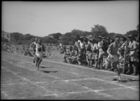 W P McHugh finishes ahead of C Masters to win the 220 yards race at NZ Division Athletics Championships, Cairo, Egypt, World War II - Photograph taken by George Kaye