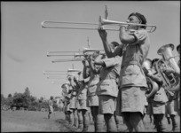 Close up of trombone players in combined bands at NZ Division Athletics Championships, Cairo, Egypt, World War II - Photograph taken by George Kaye