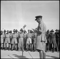 Brigadier H S Kenrick speaking at the handing over of cheque donated by repatriated POWs at 23rd NZ Field Ambulance Unit, Maadi - Photograph taken by G Bull