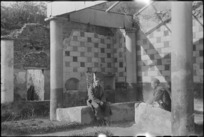 Two New Zealand soldiers rest outside ancient house in Pompei, Italy, World War II - Photograph taken by George Kaye