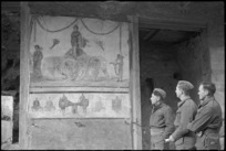 New Zealand soldiers looking at a mural in Pompei, Italy, World War II - Photograph taken by George Kaye