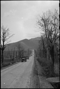 NZ transport on road on 5th Army Front in southern Italy, during World War II - Photograph taken by George Kaye