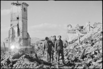 New Zealand soldiers in the main street of the ruined village of Mignano in Italy, World War II - Photograph taken by George Kaye