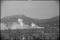Enemy shelling and counter smoke screen in the vicinity of San Pietro, Italy, World War II - Photograph taken by George Kaye