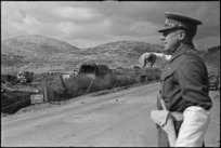 British MP directing traffic in forward areas of Monte Cassino Front, Italy, World War II - Photograph taken by George Kaye