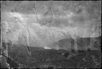 Shafts of sunlight strike through the smoke screen laid around Cassino, Italy, World War II - Photograph taken by George Kaye