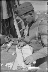 L Bernstein engaged in army carpentry work on the Cassino Front, Italy, World War II - Photograph taken by George Kaye
