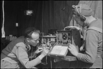 H L Willacy and I C Dalgety checking wireless sets on the Cassino Front in Italy, World War II - Photograph taken by George Kaye