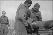 F T McClare and J H Anderson replacing the breech block of their 25 pounder in the Volturno Valley, Italy, World War II - Photograph taken by George Kaye