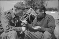 J A White and L R Poole, NZ Infantry, smoke while resting behind the lines on the Cassino Front, Italy, World War II - Photograph taken by George Kaye