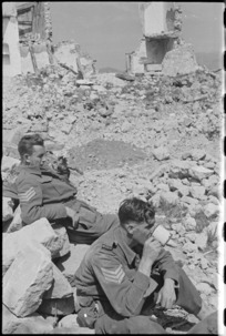 NZ Infantry sergeants W J Aldersley and E D Bougen rest among village ruins on Cassino battlefront, Italy, World War II - Photograph taken by George Kaye