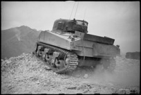 NZ Sherman tank takes up position in a ruined village in the Cassino front line area, Italy, World War II - Photograph taken by George Kaye