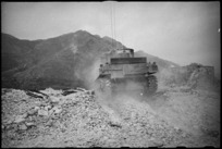 Rear view of NZ Sherman tank among ruins of village on the Cassino Front, Italy, World War II - Photograph taken by George Kaye