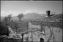 Mountains above the Volturno Valley seen past bombed house on the Italian Front, World War II - Photograph taken by George Kaye