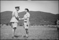 Lieutenant Colonel R L McGaffin congratulated by General Freyberg after receiving DSO at parade in Volturno Valley, Italy, World War II - Photograph taken by George Kaye