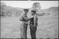 Major A Awatere receives the Military Cross from General Freyberg at 5 NZ Infantry Brigade parade in the Volturno Valley, Italy, World War II - Photograph taken by George Kaye