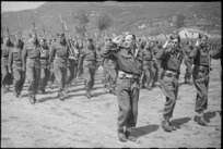 Officers and men of 5 NZ Infantry Brigade marching past in the Volturno Valley area, Italy, World War II - Photograph taken by George Kaye