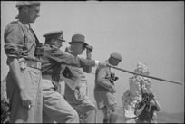 General Bernard Freyberg points out to Peter Fraser features of ruined town of Cassino, Italy, World War II - Photograph taken by George Kaye