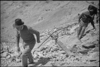Prime Minister Peter Fraser ascends steep slope of Monastery Hill, Cassino, Italy, World War II - Photograph taken by George Kaye