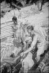 N Hunt and E J Betts maintain NZ Divisional Artillery gun in Cassino area, Italy, World War II - Photograph taken by George Kaye