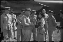 Prime Minister Peter Fraser with Lady Freyberg and senior officers at Bari Airport, Italy, World War II - Photograph taken by George Bull