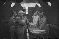 Prime Minister Peter Fraser inspects operating theatre at 1 New Zealand General Hospital, Molfetta, Italy, World War II - Photograph taken by George Bull