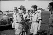 Prime Minister Peter Fraser taking leave of NZ provost who escorted him on his tour of troops in Italy, World War II - Photograph taken by George Bull