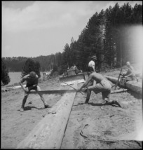 Sawing up a long log at the New Zealand Forestry Unit mill in southern Italy, World War II - Photograph taken by M D Elias