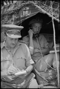 Captain A Simpson and S P Coles communicating from 29 Battery Command Post in the Sora area, Italy, World War II - Photograph taken by George Kaye