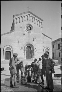 New Zealand soldiers filling water cans in the square at Sora, Italy, World War II - Photograph taken by George Kaye
