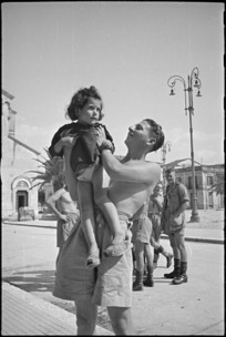 H G Kissin makes friends with an Italian child in Sora, Italy, World War II - Photograph taken by George Kaye