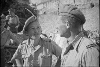 A T Wilson and L N Carter, members of 26 NZ Battalion, decorate their berets with feathers in Sora, Italy, World War II - Photograph taken by George Kaye
