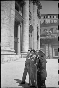 Guide pointing out features of St Peter's Basilica to World War II New Zealand soldiers on leave in Rome, Italy - Photograph taken by George Kaye