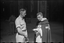G J Callander chats with a priest at the entrance to St Peter's Basilica, Rome, Italy - Photograph taken by George Kaye