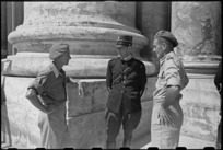 J B Savage and G A Sutherland chat with a Vatican City guard while on leave in Rome, Italy, World War II - Photograph taken by George Kaye
