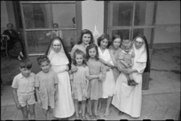 Two San Felice Convent sisters and civilian Red Cross workers with World War II refugee children in Florence, Italy - Photograph taken by George Kaye