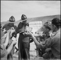 Bookmakers take bets at race meeting organised by 36 New Zealand Survey Battery in Trans Jordania, World War II - Photograph taken by M D Elias