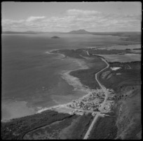 View of the eastern side of Lake Taupo with State Highway 1 and the settlement of Motuoapa to Motutaiko Island beyond