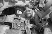 D O Long packing machine gun ammunition into a gun carrier during the advance to Florence, Italy