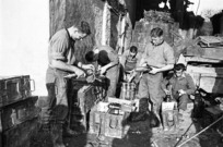 Kaye, George, 1914- : NZ mortar crew near Faenza, Italy, preparing ammunition within one thousand yards of the enemy