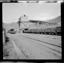 Railway wagons at Avoca, snow covered mountains in the background