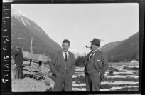 Two unidentified men, one smoking a pipe, at Arthur's Pass Railway Station, Selwyn District, Canterbury Region