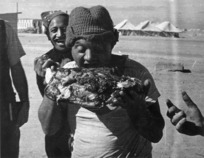 Bull, George Robert, 1910-1966 : Soldier R White with a leg of pork from the hangi at the Maori Training Depot, Maadi, Christmas Day