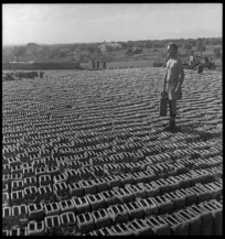 New Zealand soldier and petrol cans, Taranto, Italy, during World War 2