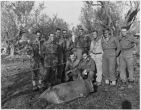 New Zealand soldiers grouped about an undetonated enemy bomb - Photograph taken by George Frederick Kaye