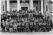 Creator unknown: Photograph of politicians, and a group of Maori, on the steps of Parliament, Wellington