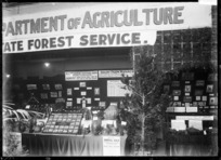 Stall at a trade fair advertising and displaying products produced by, and courses run by the Department of Agriculture and State Forest Service