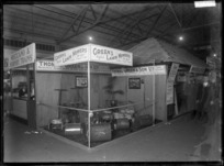A stand at a trade fair in 1930, advertising Green's lawn mowers, with H J Ryan, sole agent, 26 St Paul's St, Auckland.