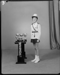 Unidentified member of the Crystal Cadets marching team of 1969 with trophies